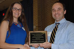 Student accepting award from Dr. Mattos
