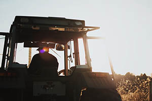 Photo of a man driving a tractor
